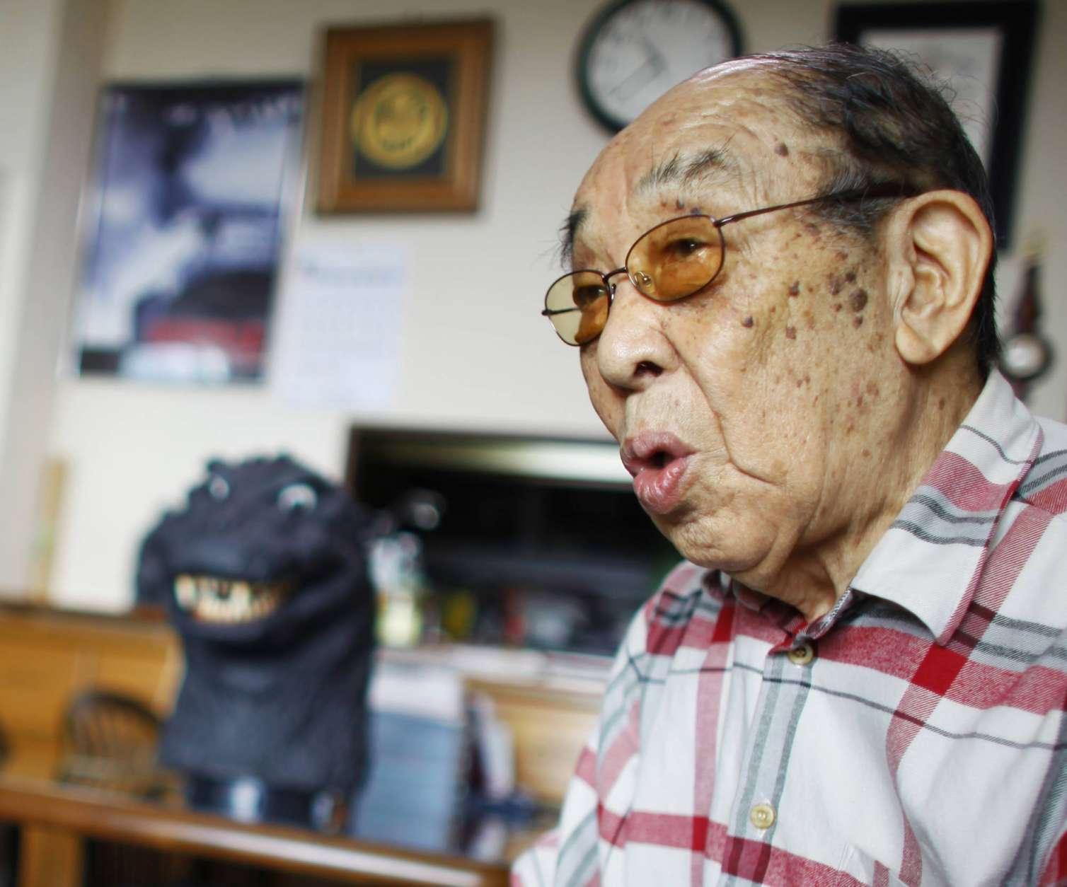 FILE - In this April 28, 2014 photo, original Godzilla suit actor Haruo Nakajima, who has played his role as the monster, speaks during an interview at his home in Sagamihara, near Tokyo. Nakajima, the actor who stomped in a rubber suit to portray the original 1954 Godzilla, has died on Monday, Aug. 7, 2017. He was 88. (AP Photo/Junji Kurokawa, File)