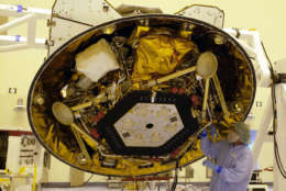 A technician makes checks on NASA's Phoenix Mars Lander in the Payload Hazardous Servicing Facility at the Kennedy Space Center in Cape Canaveral, Fla. Tuesday, June 26, 2007. The Phoenix spacecraft is scheduled for launch on a Delta II rocket Aug. 3. It will land in the arctic region of Mars. (AP Photo/Peter Cosgrove)