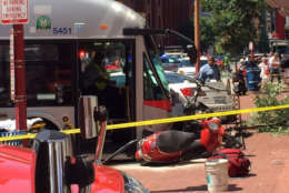 Photo of the scene where a bus crashed into a building on the 600 block of H Street NW. (WTOP/James Hoeflinger)