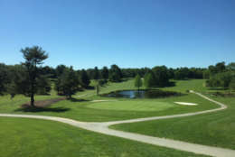 The view from the snack bar above the clubhouse looking back at the 18th green at Needwood Golf Course. (WTOP/Mike Jakaitis)