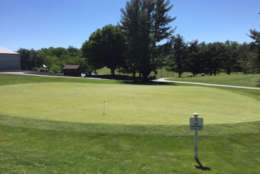 The course has a couple putting greens and a 20-stall driving range (in the background). (WTOP/Mike Jakaitis)
