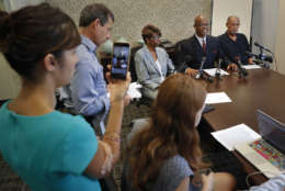 """Attorney Ted Williams, right center, for Barbara, center, and Phillip Butler, right, victims of a cross burning on their property forty years ago, speaks during a news conference at Williams office in Washington, Wednesday, Aug. 23, 2017. Forty years ago, Catholic Priest William Aitcheson, was a Ku Klux Klan """"wizard"""", has come forward after decades as a Catholic priest, he's coming forward about his past. (AP Photo/Pablo Martinez Monsivais)"""