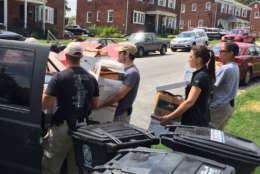 An early morning raid Thursday on Saint Clair Drive in Temple Hills, Maryland preceded more than eight hours of evidence collecting at the residence. (WTOP/Kristi King)