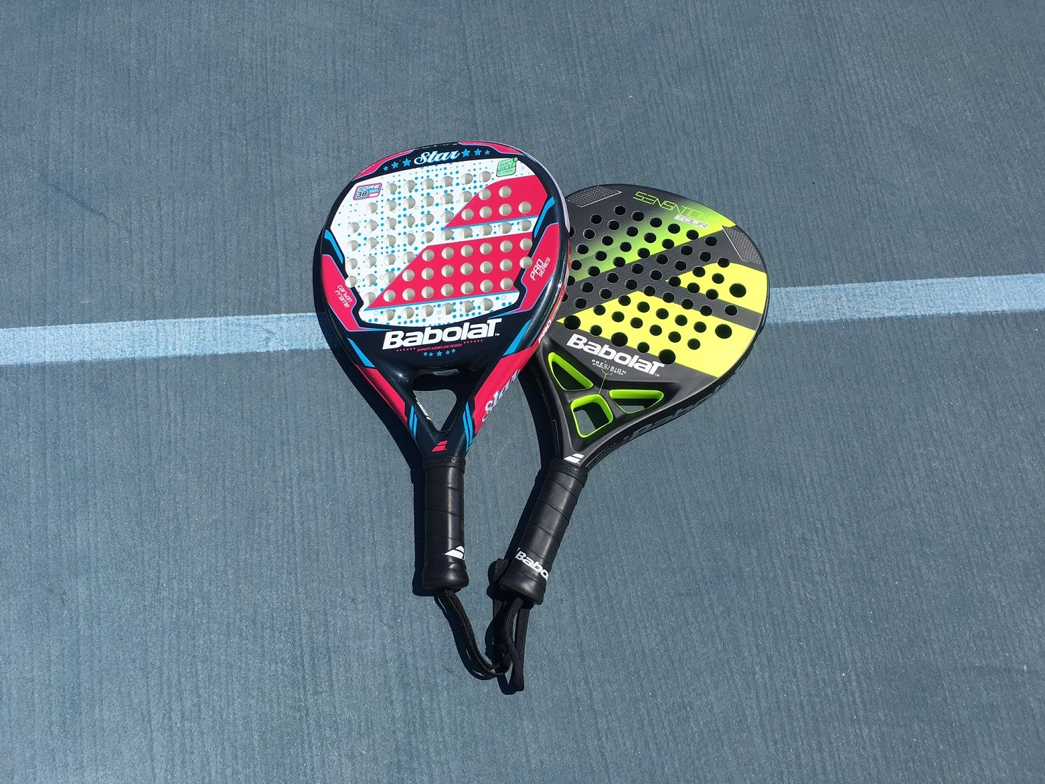 POP Tennis rackets are made of a memory foam composite and are several inches shorter than a traditional racket. (WTOP/Noah Frank)