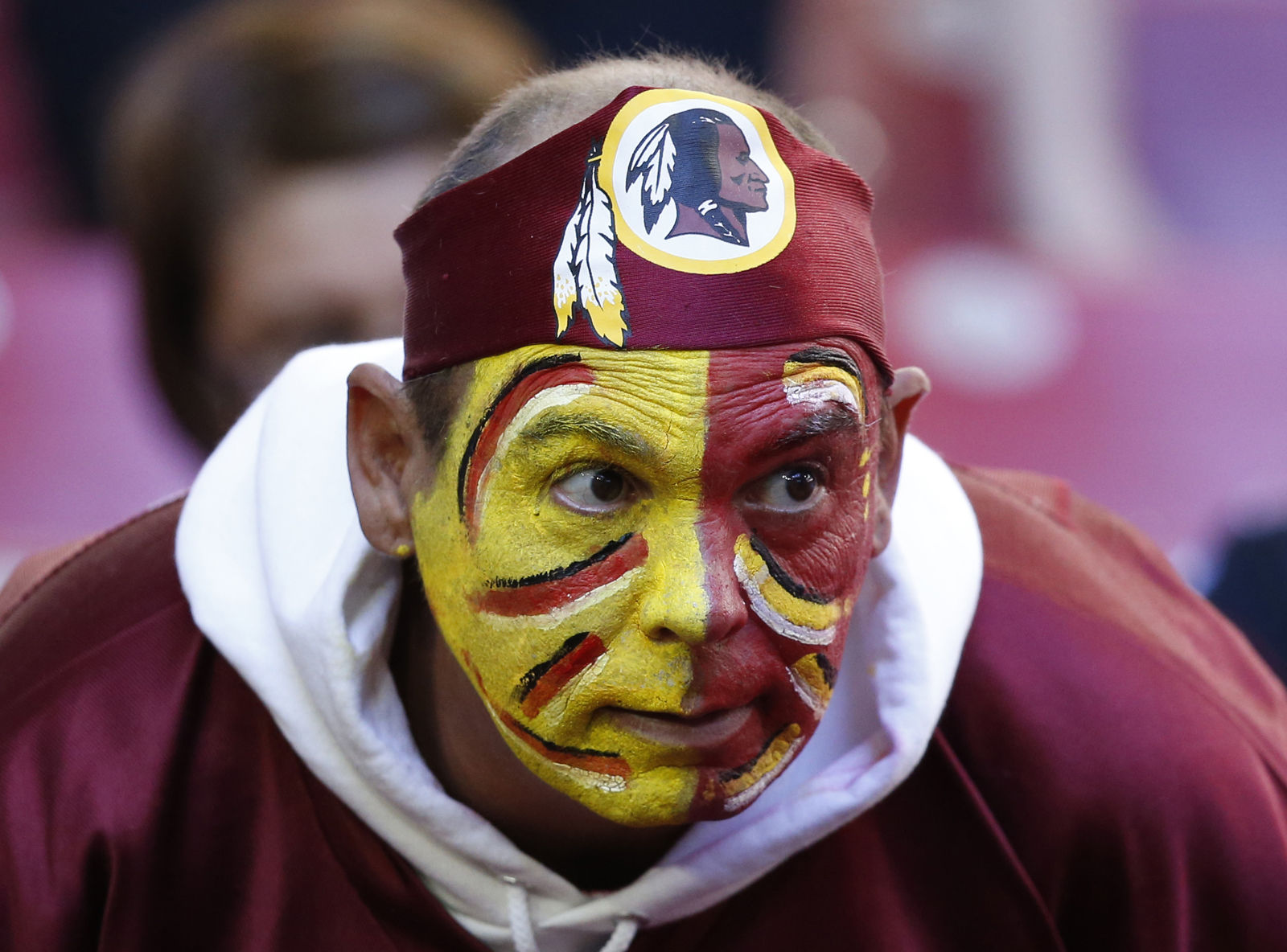 "Green Acres School sent a letter to families announcing the change, saying children and staff members should not be wearing clothing that ""disparages a race of people.""  FILE. A Washington Redskins fan watches prior to an NFL football game against the Arizona Cardinals, Sunday, Dec. 4, 2016, in Glendale, Ariz. (AP Photo/Ross D. Franklin)"