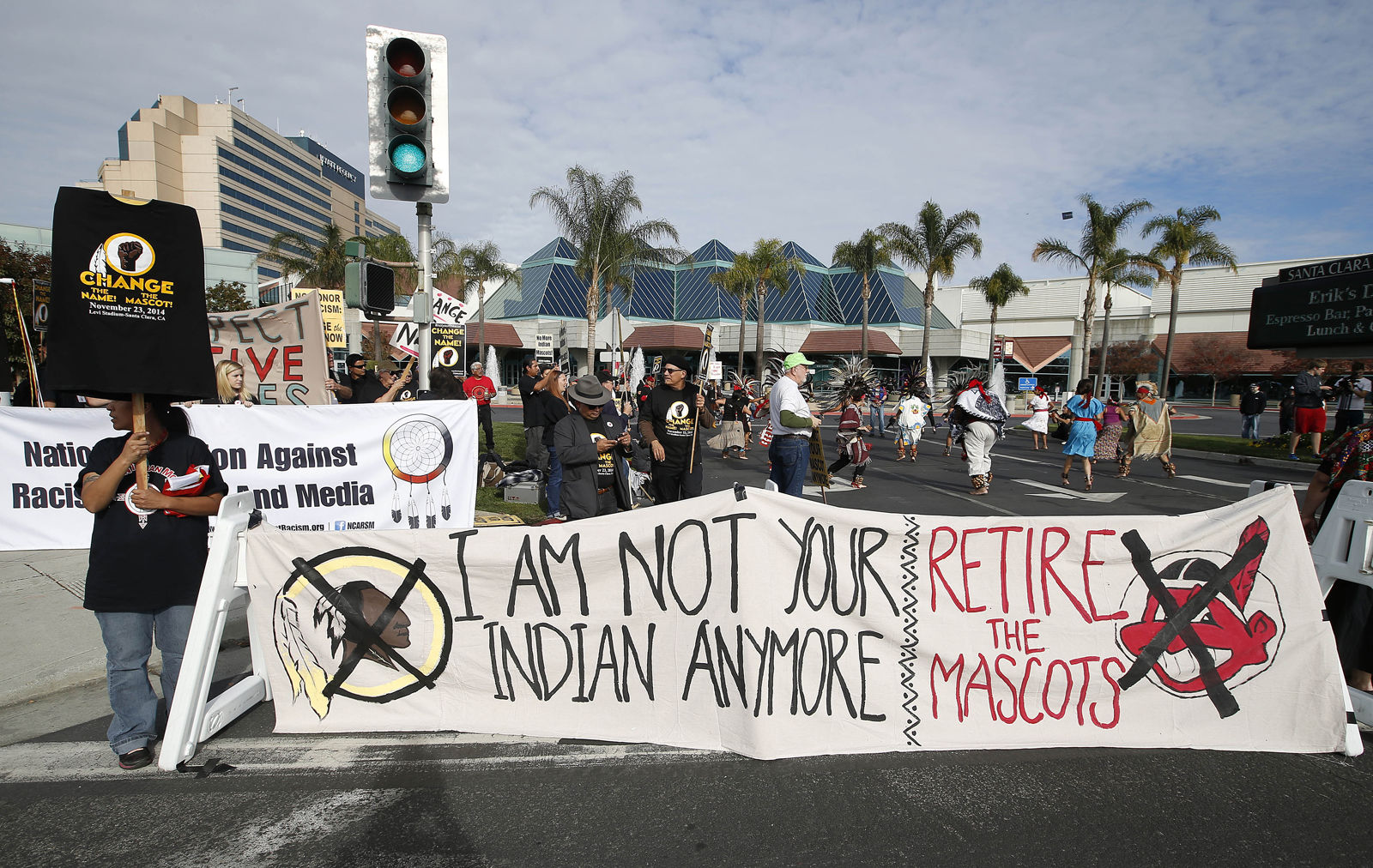 Many activists say the name Redskins is offensive, in recent years there has been an increased effort to attempt to get the team to change the name. In this photo from 2014, a group protests the Washington Redskins name across from Levi's Stadium before an NFL football game between the Redskins and the San Francisco 49ers. (AP Photo/Tony Avelar)