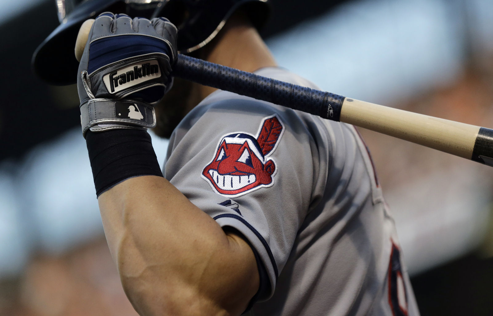 The Cleveland Indians logo, seen here on Ryan Raburn's jersey in 2015 during a game against the Orioles, has been in use since 1949, though in more recent years it has become less visible on the team's uniforms. The Indians' owner, Paul Dolan, has said that he prefers to keep the logo in a limited capacity and expects a resolution within a couple of years.  (AP Photo/Patrick Semansky)