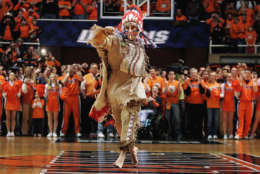 "In August 2017, the University of Illinois announced it was stopping their practice of playing a ""war chant"" at games. In 2007, the school ditched its long time mascot, Chief Illiniwek.    FILE - In this Feb. 21, 2007 file photo, University of Illinois mascot Chief Illiniwek performs for the last time during an Illinois basketball game in Champaign, Ill.  (AP Photo/Seth Perlman, File)"