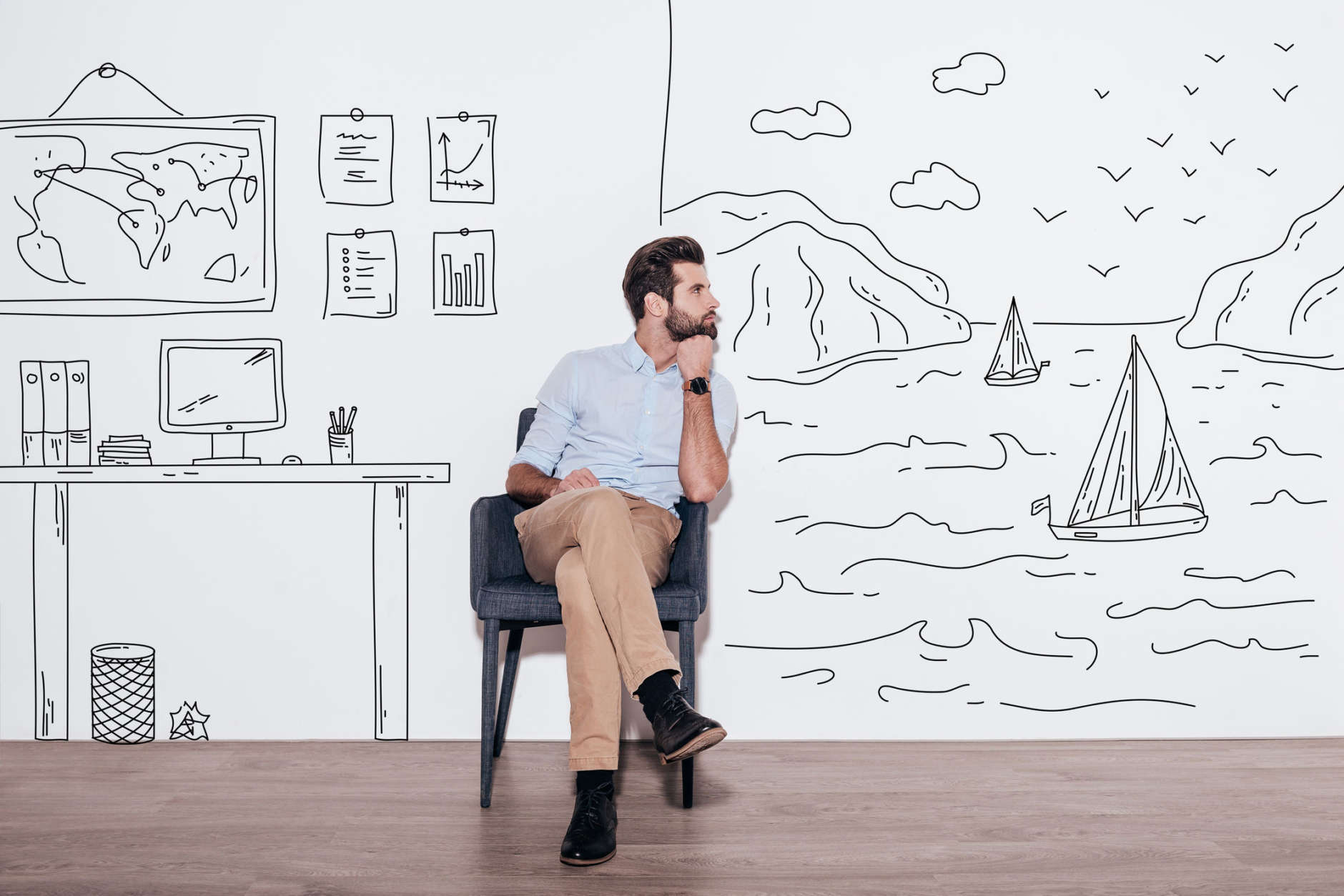 Young handsome man keeping hand on chin and looking away while sitting in the chair against illustration of fjord vs. working place