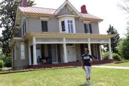 """This June 15, 2017 photo shows gymnast and Olympic gold medalist Dominique Dawes visiting the Frederick Douglass house in Washington, D.C., as an ambassador for the National Park Service. The National Park Service is marking its 101st birthday amid a """"Parks 101"""" campaign enlisting celebrities, actors, athletes and others to help publicize sites that get less visitation than the big parks like Yellowstone and the Grand Canyon. (Ryan Hallett/National Park Foundation via AP)"""