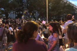 Protesters in front of the statue of Albert Pike in D.C. lit candles for those hurt and killed during the violence in Charlottesville, Virginia on Aug. 12. (WTOP/Liz Anderson)