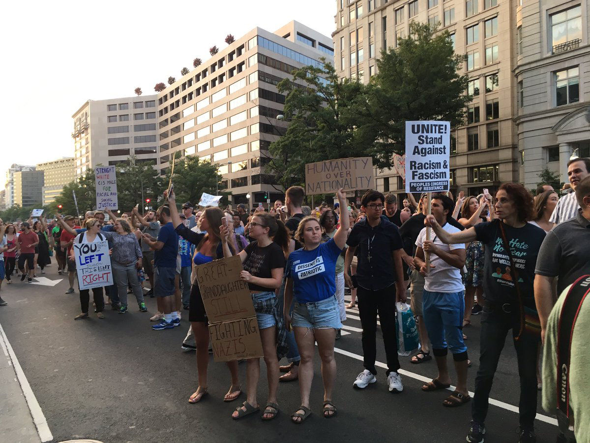 """Protesters stopped in front of the Trump Hotel with shouts of """"Shame! Shame! Shame!"""" (WTOP/Liz Anderson)"""