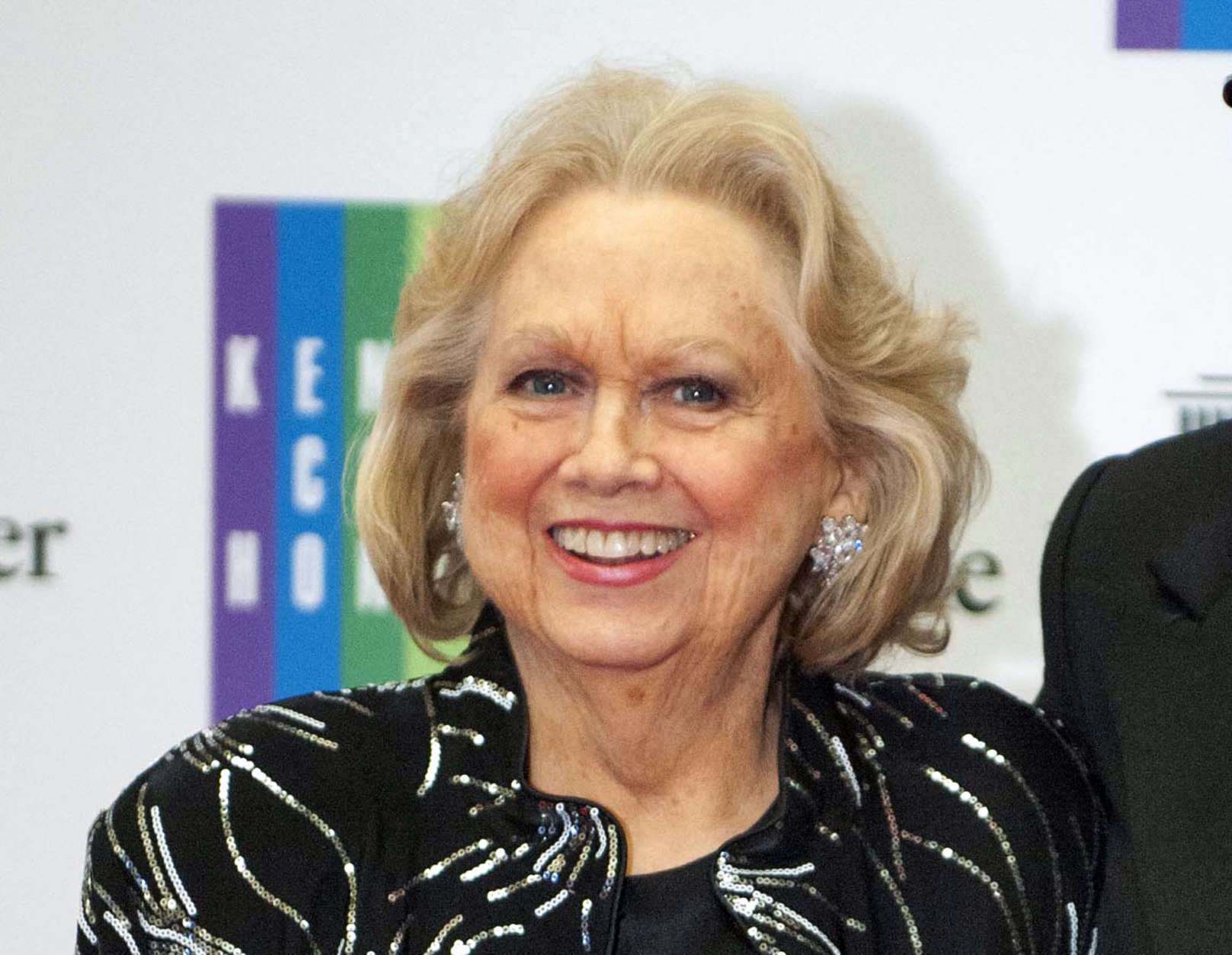 """FILE - In this Dec. 7, 2013 file photo, Barbara Cook arrives at the State Department for the Kennedy Center Honors gala dinner in Washington. Cook's return to a New York stage in a show about her life has been postponed. Producers said Monday, March 28, 2016, that """"Barbara Cook: Then and Now,"""" conceived by James Lapine and directed by Tommy Tune, will not be staged this spring at the New World Stages complex. (AP Photo/Kevin Wolf, File)"""