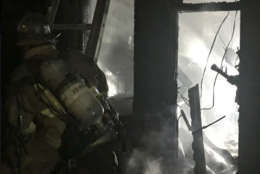 Firefighters battle the blaze at F St. NE where one of their own was injured. (Courtesy D.C. Fire and EMS)