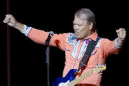 In this photo taken Thursday, Sept. 6, 2012, singer Glen Campbell performs during his Goodbye Tour in Little Rock, Ark. (AP Photo/Danny Johnston)