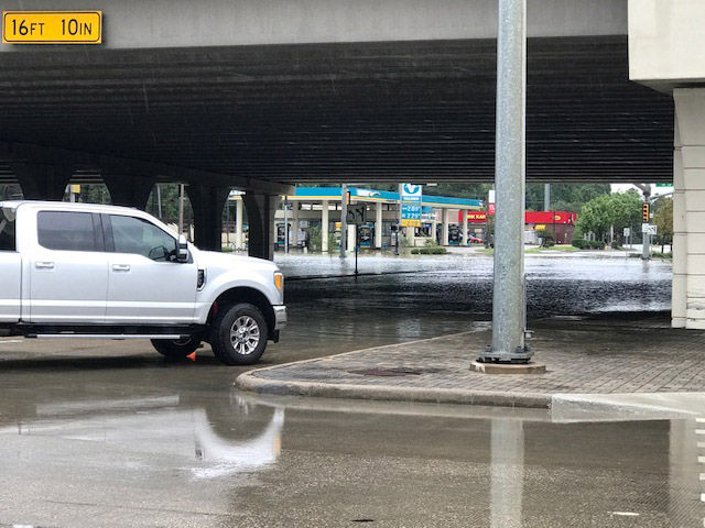 """Roads flood and the power is out on the west side of Houston along the Interstate 10 """"energy corridor"""" on Tuesday, Aug. 29, 2017. (WTOP/Steve Dresner)"""