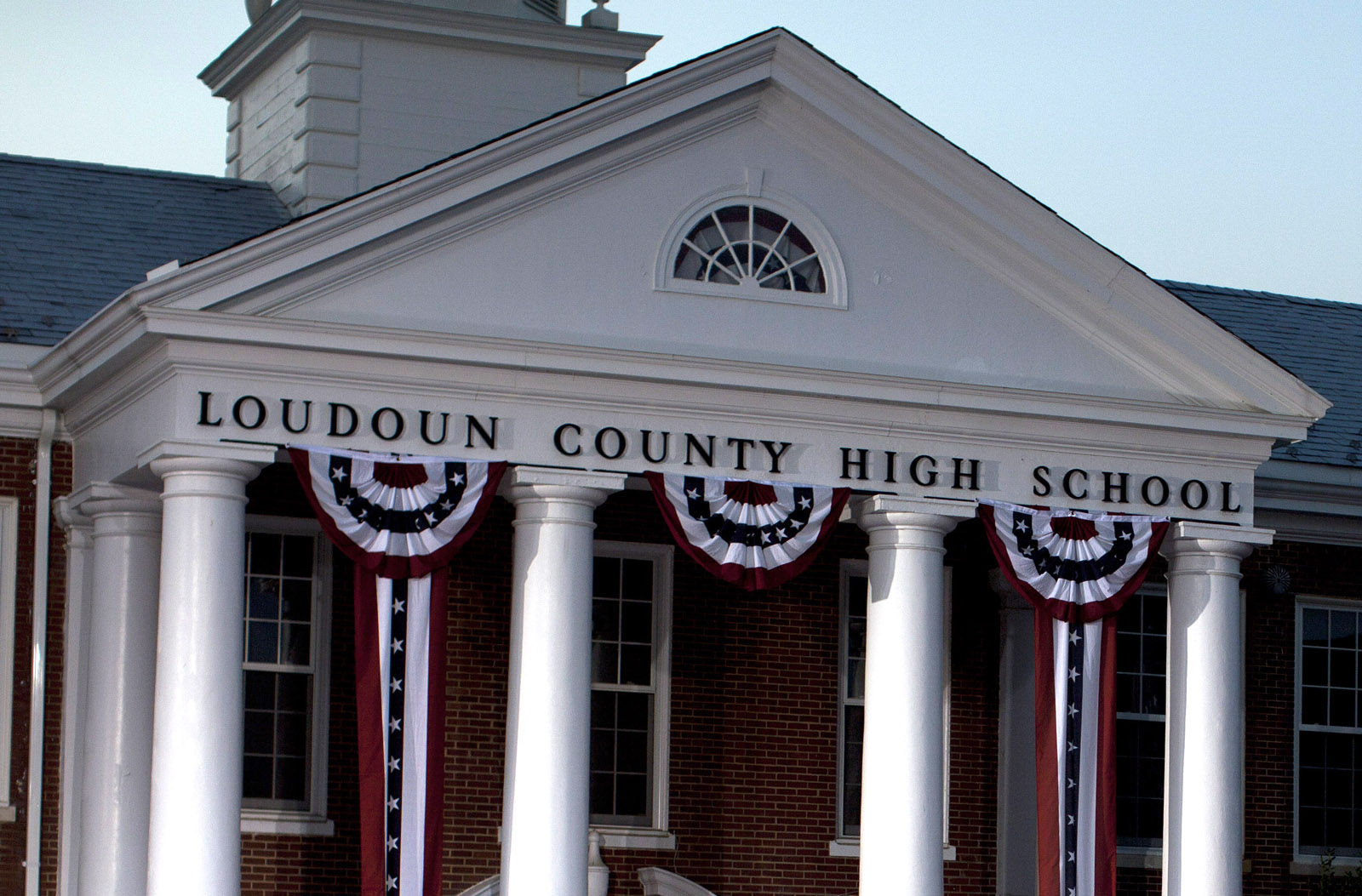 Loudoun County High School is seen in this 2012 file photo. Allison Briel, 25, of Leesburg, Virginia — a marketing education teacher at Loudoun County High School— is facing three misdemeanor charges after inappropriately communicating with students. (AP Photo/Evan Vucci)