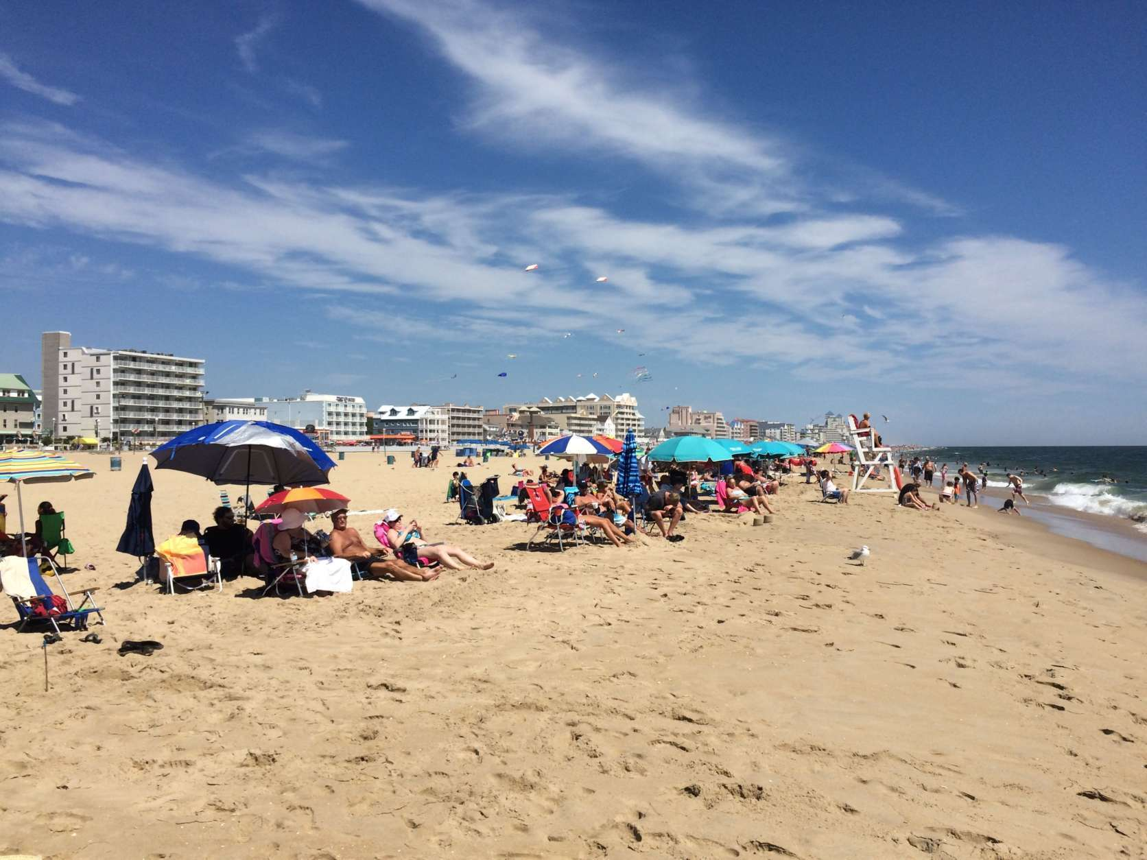 Photo shows people in bathing suits on the beach at Ocean City, Maryland