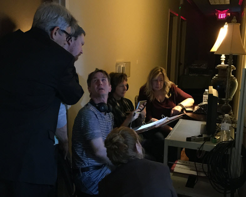 """Director John Ware looks up at actor Eric Roberts, during production of """"Unbridled."""" (Courtesy Rene Sandler)"""