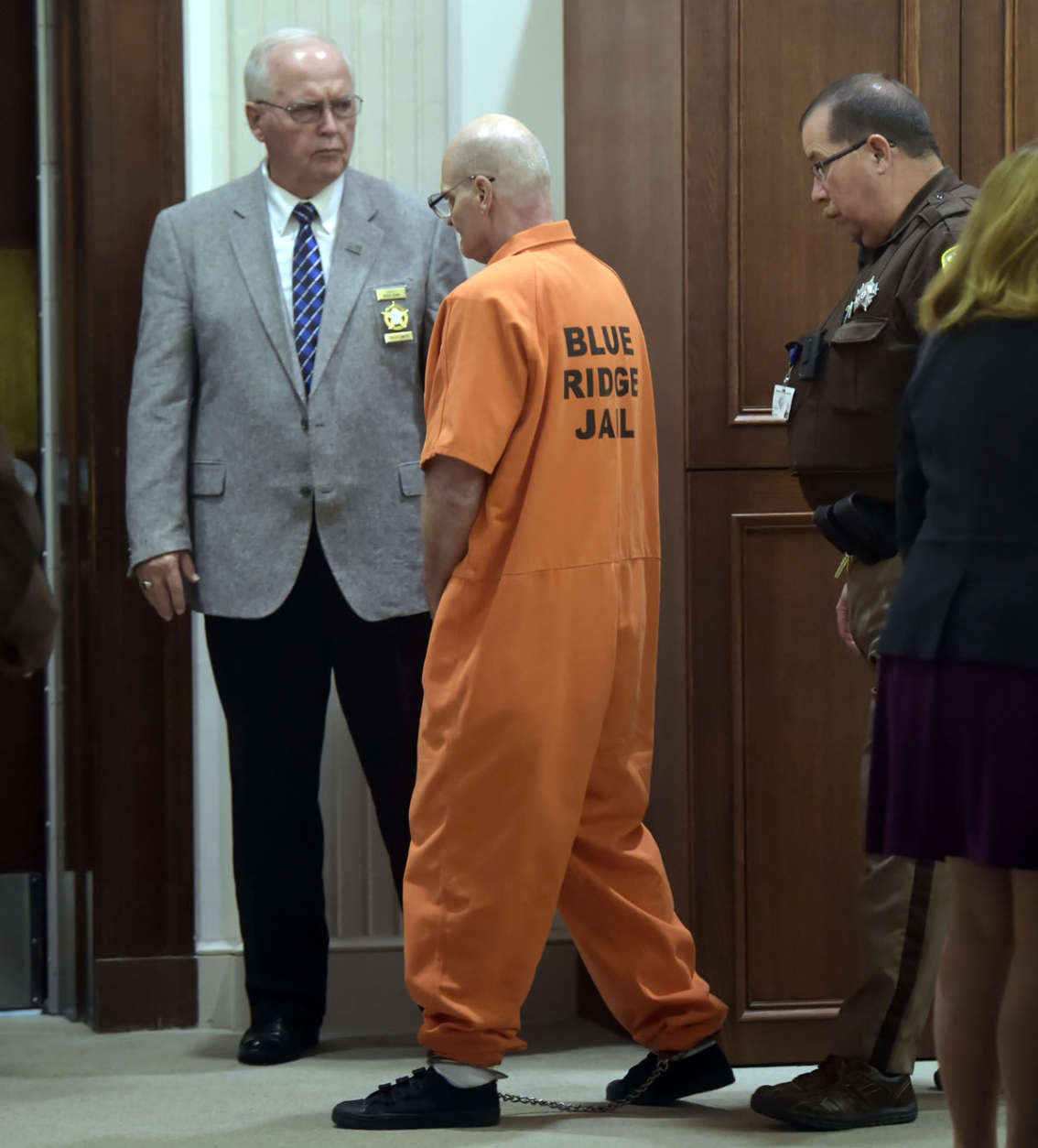 Lloyd Lee Welch Jr., center, is led out of court after a plea agreement hearing for the killings of Sheila and Katherine Lyon in 1975, in Bedford County Circuit Court in Bedford, Va., Tuesday, Sept. 12, 2017. Welch plead guilty to two counts of first degree murder and was sentenced to two consecutive 48-year terms. (Lathan Goumas /News & Daily Advance via AP, Pool)