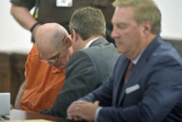 Lloyd Lee Welch Jr., left, talks with attorney Aaron Houchens, center, along with Tony anderson, right, during his plea hearing for the killings of Sheila and Katherine Lyon in 1975, in Bedford County Circuit Court in Bedford, Va., Tuesday, Sept. 12, 2017. Welch plead guilty to two counts of first degree murder and was sentenced to two consecutive 48 year sentences. (Lathan Goumas /News & Daily Advance via AP, Pool)