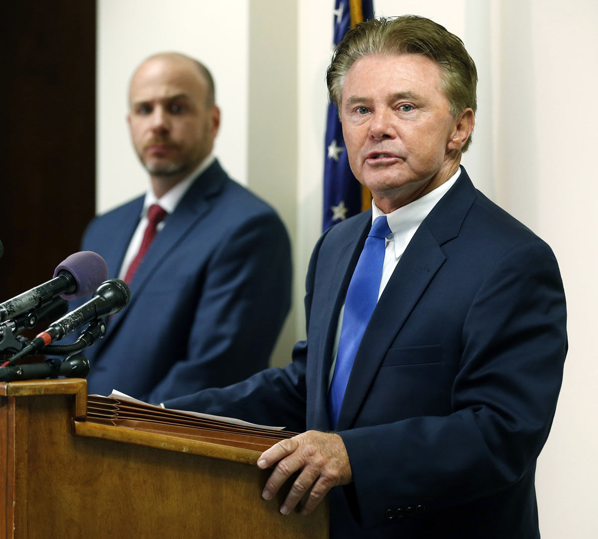 John McCarthy, Montgomery County Md., States Attorney, right, talks to the media along with Bedford County Prosecutor Wes Nance, left, after a plea by Lloyd Lee Welch Jr., for the killings of Sheila and Katherine Lyon in 1975, in Bedford County Circuit Court in Bedford, Va., Tuesday, Sept. 12, 2017. Welch plead guilty to two first degree murder charges and was sentenced to two consecutive 48-year terms. (AP Photo/Steve Helber)