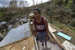 Jose Colon walks up the stairs of his friend's destroyed home, in the aftermath of Hurricane Maria, in Aibonito, Puerto Rico, Monday, Sept. 25, 2017. The U.S. ramped up its response Monday to the humanitarian crisis in Puerto Rico while the Trump administration sought to blunt criticism that its response to Hurricane Maria has fallen short of it efforts in Texas and Florida after the recent hurricanes there. (AP Photo/Gerald Herbert)
