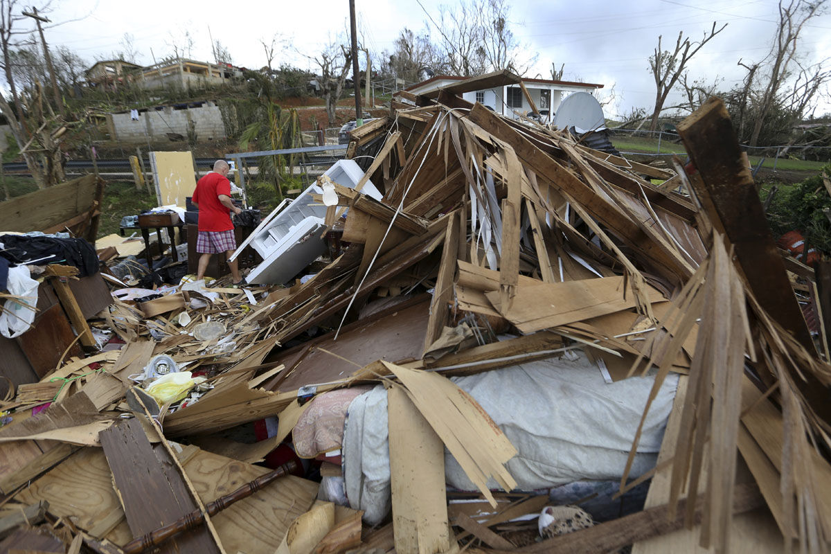 Jose Garcia Vicente walks through rubble of his destroyed home, in the aftermath of Hurricane Maria, in Aibonito, Puerto Rico, Monday, Sept. 25, 2017. The U.S. ramped up its response Monday to the humanitarian crisis in Puerto Rico while the Trump administration sought to blunt criticism that its response to Hurricane Maria has fallen short of it efforts in Texas and Florida after the recent hurricanes there. (AP Photo/Gerald Herbert)
