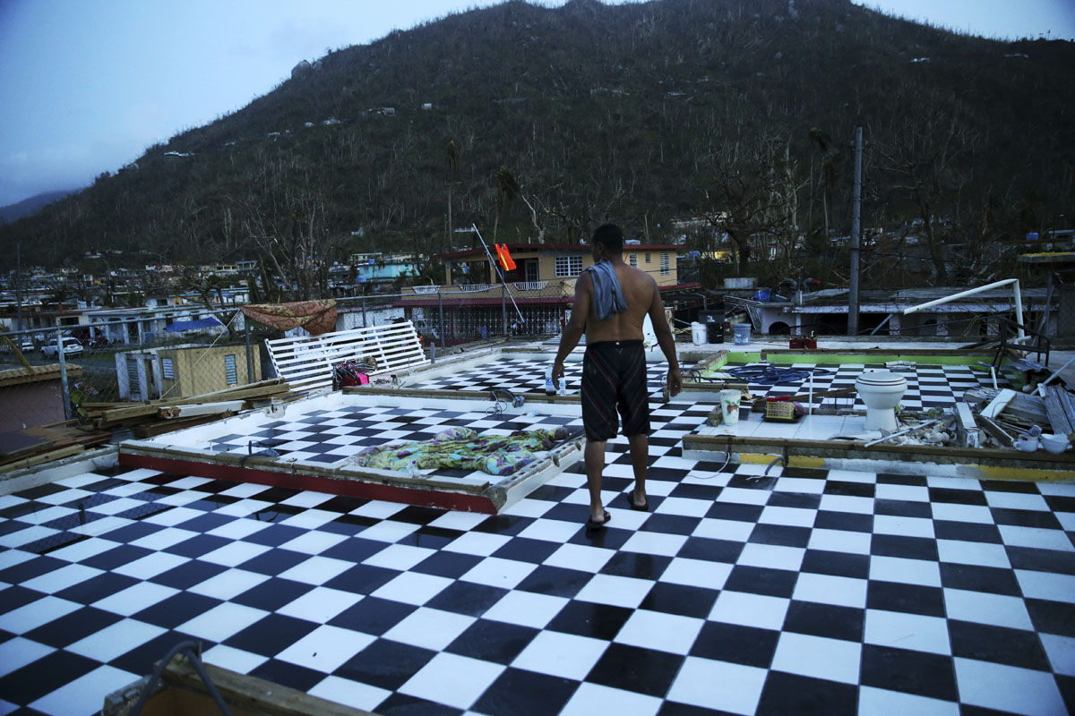 Nestor Serrano walks on the upstairs floor of his home, where the walls were blown off, in the aftermath of Hurricane Maria, in Yabucoa, Puerto Rico, Tuesday, Sept. 26, 2017. Governor Ricardo Rossello and Resident Commissioner Jennifer Gonzalez, the island's representative in Congress, have said they intend to seek more than a billion in federal assistance and they have praised the response to the disaster by President Donald Trump, who plans to visit Puerto Rico next week, as well as FEMA Administrator Brock Long.  (AP Photo/Gerald Herbert)