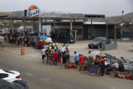 COROZAL, PUERTO RICO - SEPTEMBER 27:  People wait in line for gas as they deal with the aftermath of Hurricane Maria on September 27, 2017 in Corozal, Puerto Rico.  Puerto Rico experienced widespread, severe damage including most of the electrical, gas and water grids as well as agricultural destruction after Hurricane Maria, a category 4 hurricane, passed through.  (Photo by Joe Raedle/Getty Images)