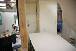 COROZAL, PUERTO RICO - SEPTEMBER 27:  Irma Santiago salvages what she can from her home that was destroyed when Hurricane Maria passed through on September 27, 2017 in Corozal, Puerto Rico.  Puerto Rico experienced widespread damage including most of the electrical, gas and water grid as well as agriculture after Hurricane Maria, a category 4 hurricane, passed through.  (Photo by Joe Raedle/Getty Images)