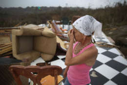 COROZAL, PUERTO RICO - SEPTEMBER 27:  Irma Maldanado stands in what is left of her home that was destroyed when Hurricane Maria passed through on September 27, 2017 in Corozal, Puerto Rico.  Puerto Rico experienced widespread damage including most of the electrical, gas and water grid as well as agriculture after Hurricane Maria, a category 4 hurricane, passed through.  (Photo by Joe Raedle/Getty Images)