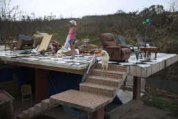 COROZAL, PUERTO RICO - SEPTEMBER 27:  Irma Maldanado stands with Sussury her parrot and her dog in what is left of her home that was destroyed when Hurricane Maria passed through on September 27, 2017 in Corozal, Puerto Rico.  Puerto Rico experienced widespread damage including most of the electrical, gas and water grid as well as agriculture after Hurricane Maria, a category 4 hurricane, passed through.  (Photo by Joe Raedle/Getty Images)