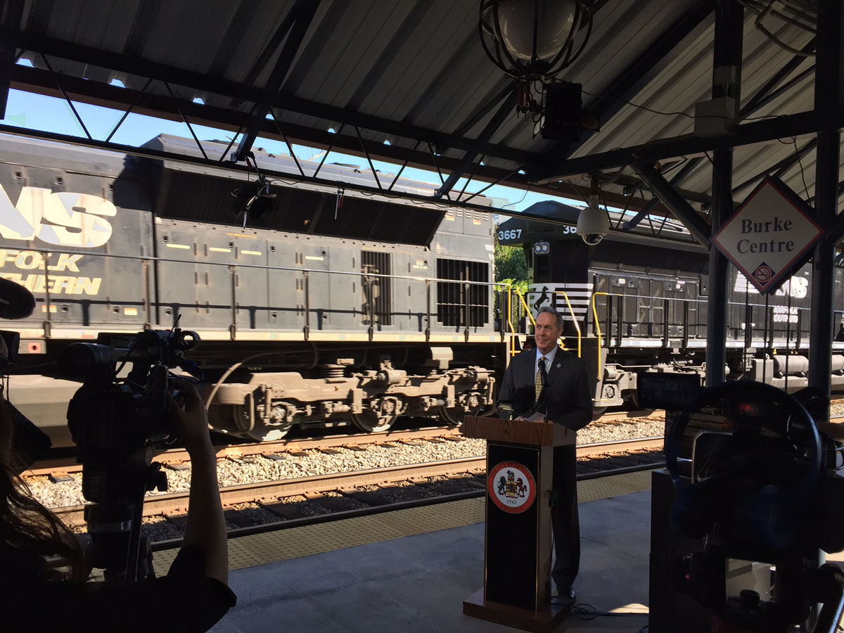VRE CEO Doug Allen VRE pauses as a freight train rumbles by during his remarks at the first national Rail Safety Week. (WTOP/John Aaron)