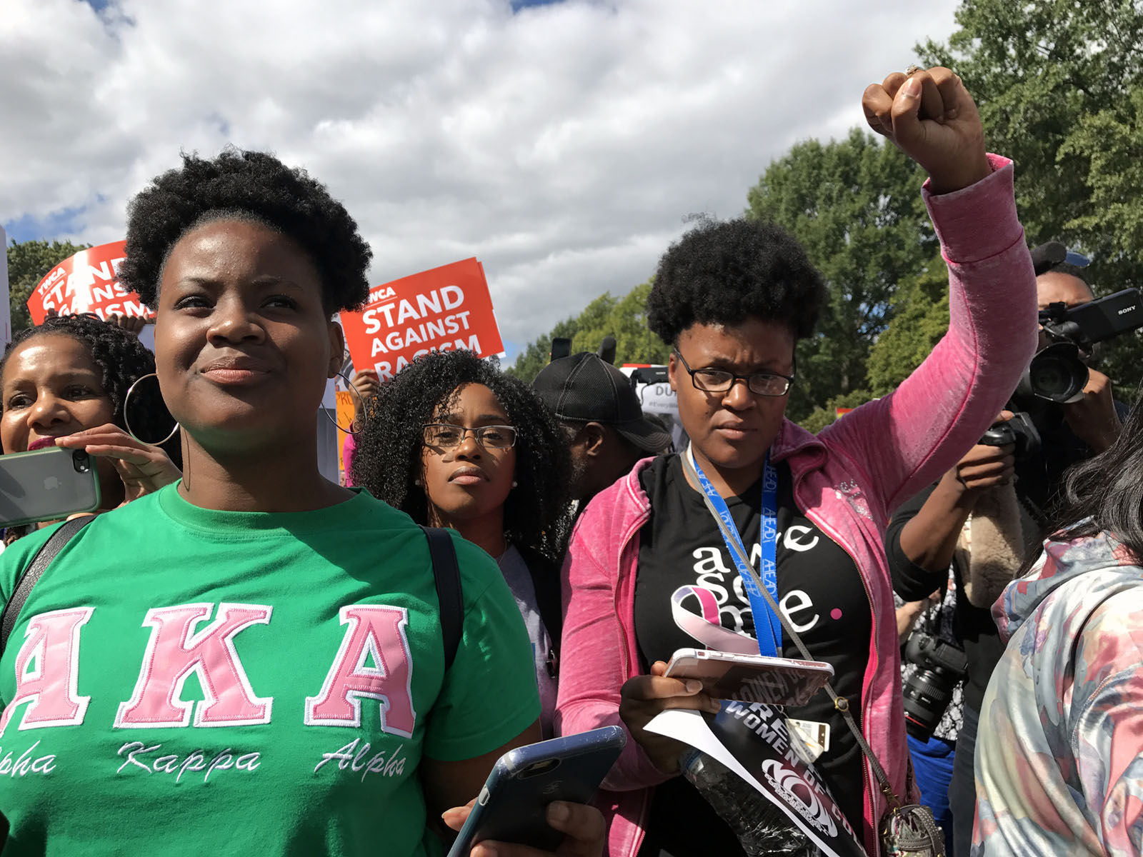 The large, multiracial crowd gathered at Lincoln Park on Capitol Hill, where they chanted and sang songs, listened to speeches and mingled in the breezy, sun-drenched autumn day.(WTOP/Dick Uliano)