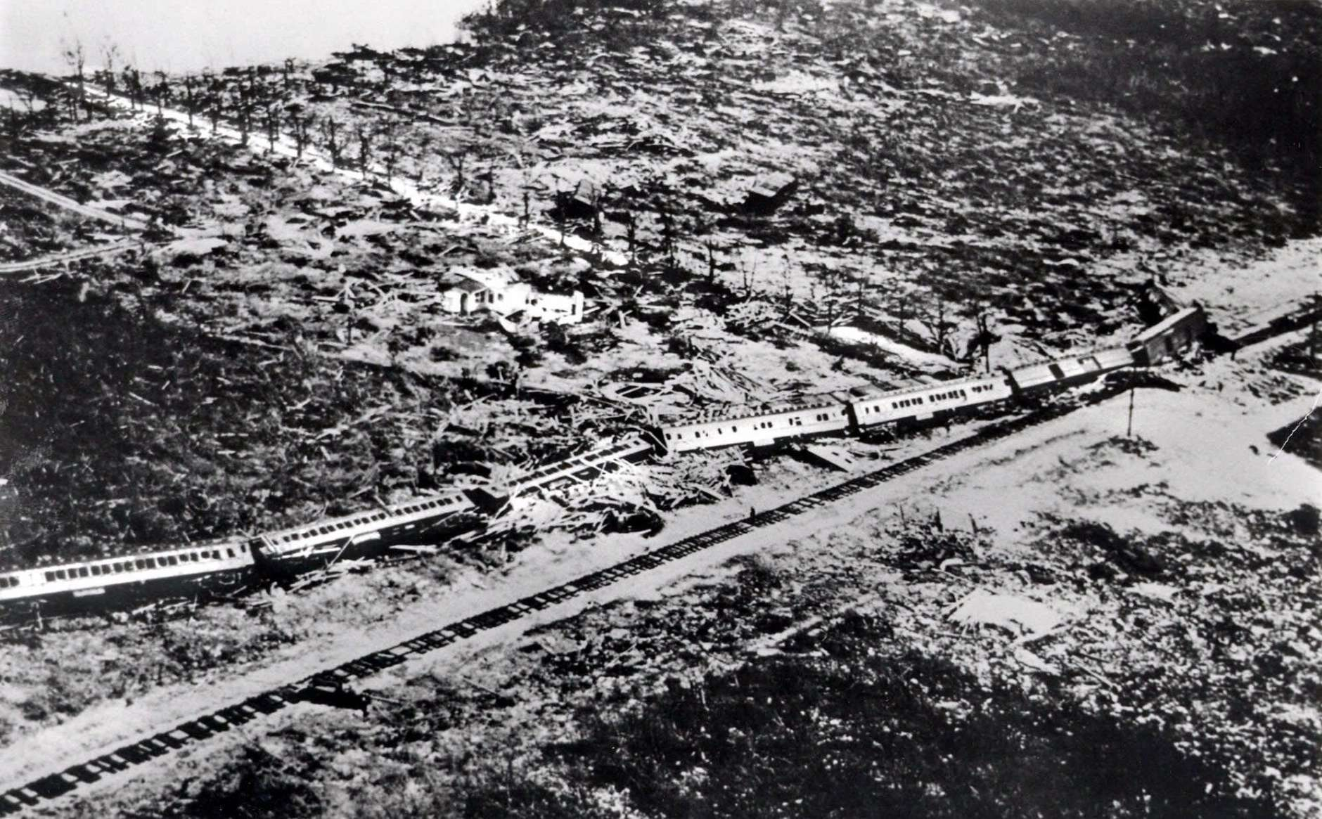 "FILE - This September 1935 file photo shows the wreckage of an 11-car passenger train that was derailed by a Labor Day hurricane in the Florida Keys.  The Hurricane Center says no wind measurements were available from the core of this small but ""vicious"" hurricane, which was a Category 5 storm when it reached the Florida Keys. But a pressure measurement taken at Long Key, Fla., makes it the most intense hurricane ever to make landfall on the U.S. mainland. It was blamed for 408 deaths and caused an estimated $6 million (1935 dollars) in damage. (AP Photo, File)"