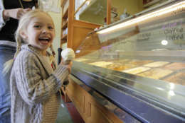 In this photo taken Wednesday June 1, 2011, Sophia Santos, 4, smiles after getting an ice cream cone at the Bi-Rite Creamery in San Francisco, Calif. At Bi-Rite Creamery, both their scooped and soft serve ice cream offerings are made from Straus Family Organic Dairy products.    (AP Photo/Eric Risberg)