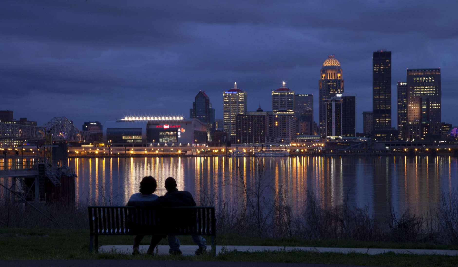 George Murff of Indianapolis sits with his friend Jasmine Riddlespriger of Clarksville, Ind., as they watch the Ohio river flow past Louisville, Ky., Friday, March 16, 2012. (AP Photo/Dave Martin)