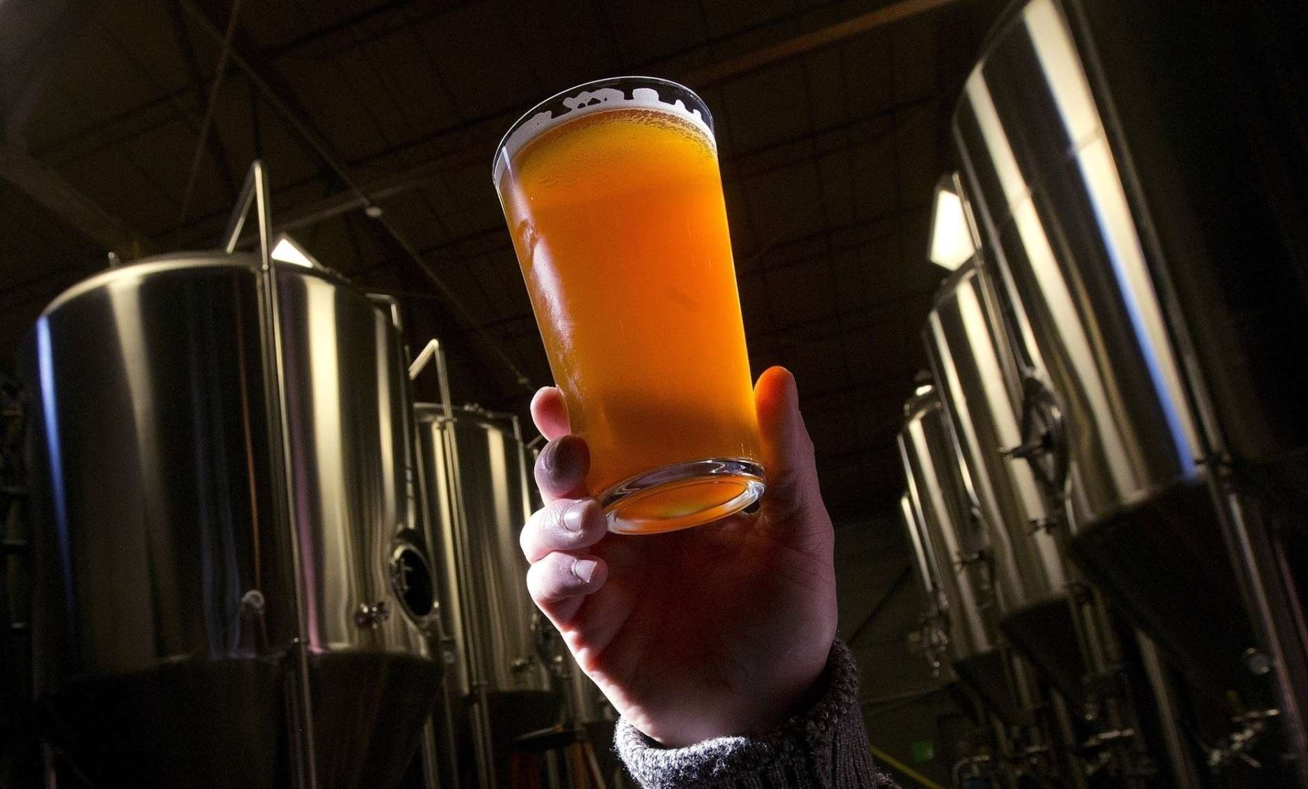FILE - In this Dec. 11, 2013, file photo, brewer Stefano Daneri holding up a beer at Good People Brewing in Birmingham, Ala. Alabama's alcohol regulators want the name, address, age and phone number of everyone who buys beer in one of the state's craft breweries and takes it home to drink, a move that is raising concerns about privacy. he Alabama Alcoholic Beverage Control Board is considering a new rule that would require brewers to collect the personal information of anyone who purchases beer at a brewery for off-premise consumption. (AP Photo/Dave Martin, File)