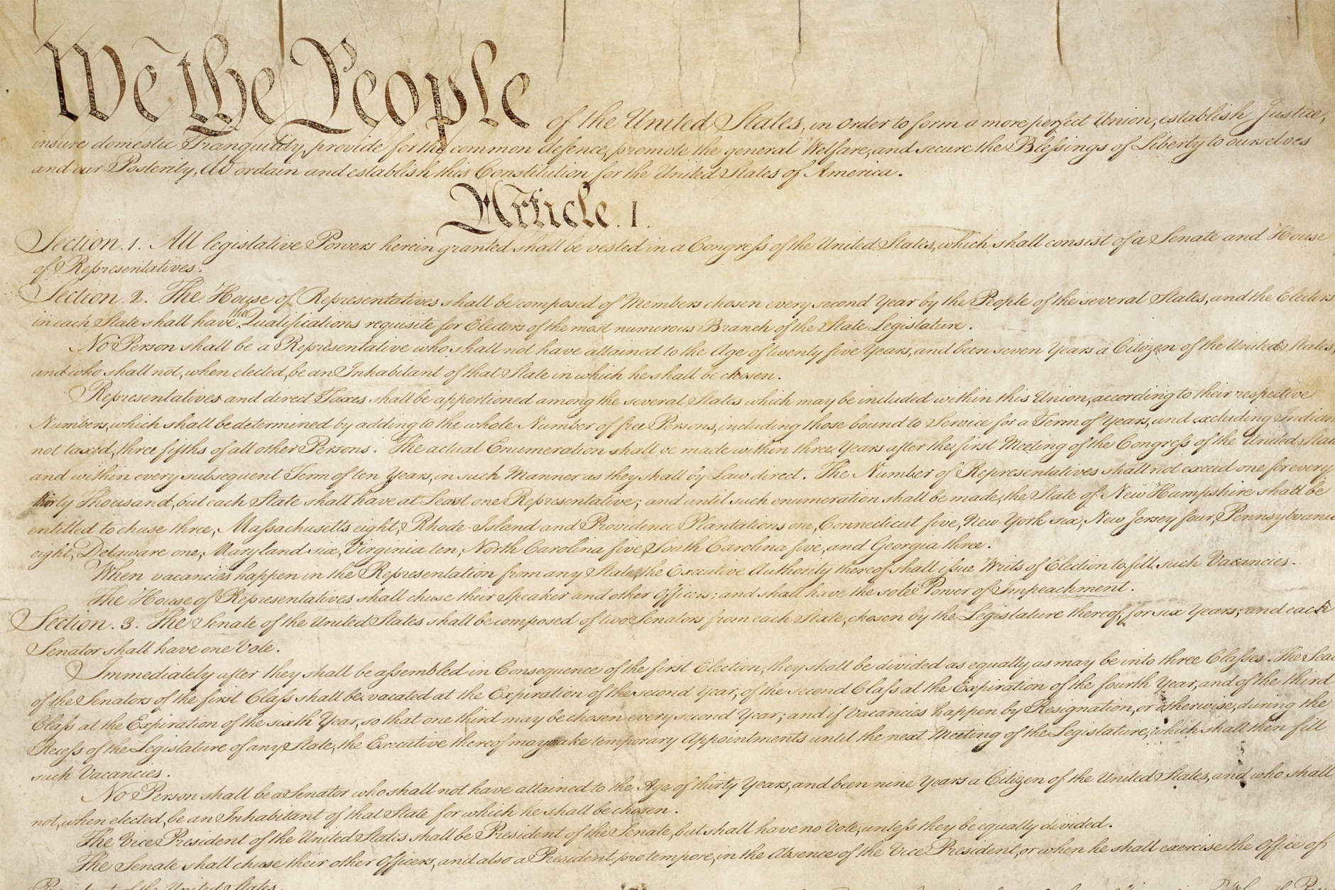 This photo made available by the U.S. National Archives shows a portion of the first page of the United States Constitution. (National Archives via AP)