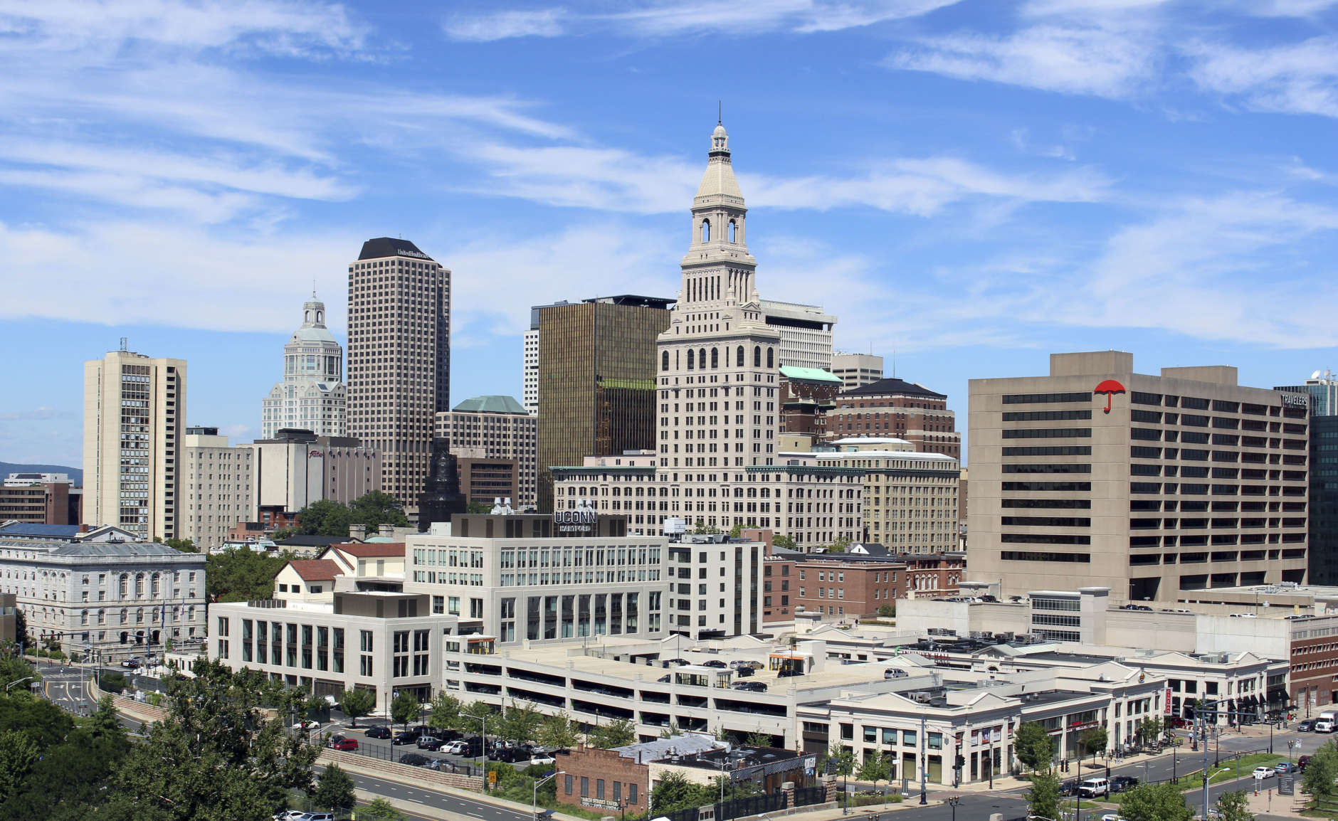 The Travelers Companies tower, center, anchors the skyline of downtown Hartford, Conn., Wednesday, Aug. 23, 2017. (AP Photo/Pat Eaton-Robb)