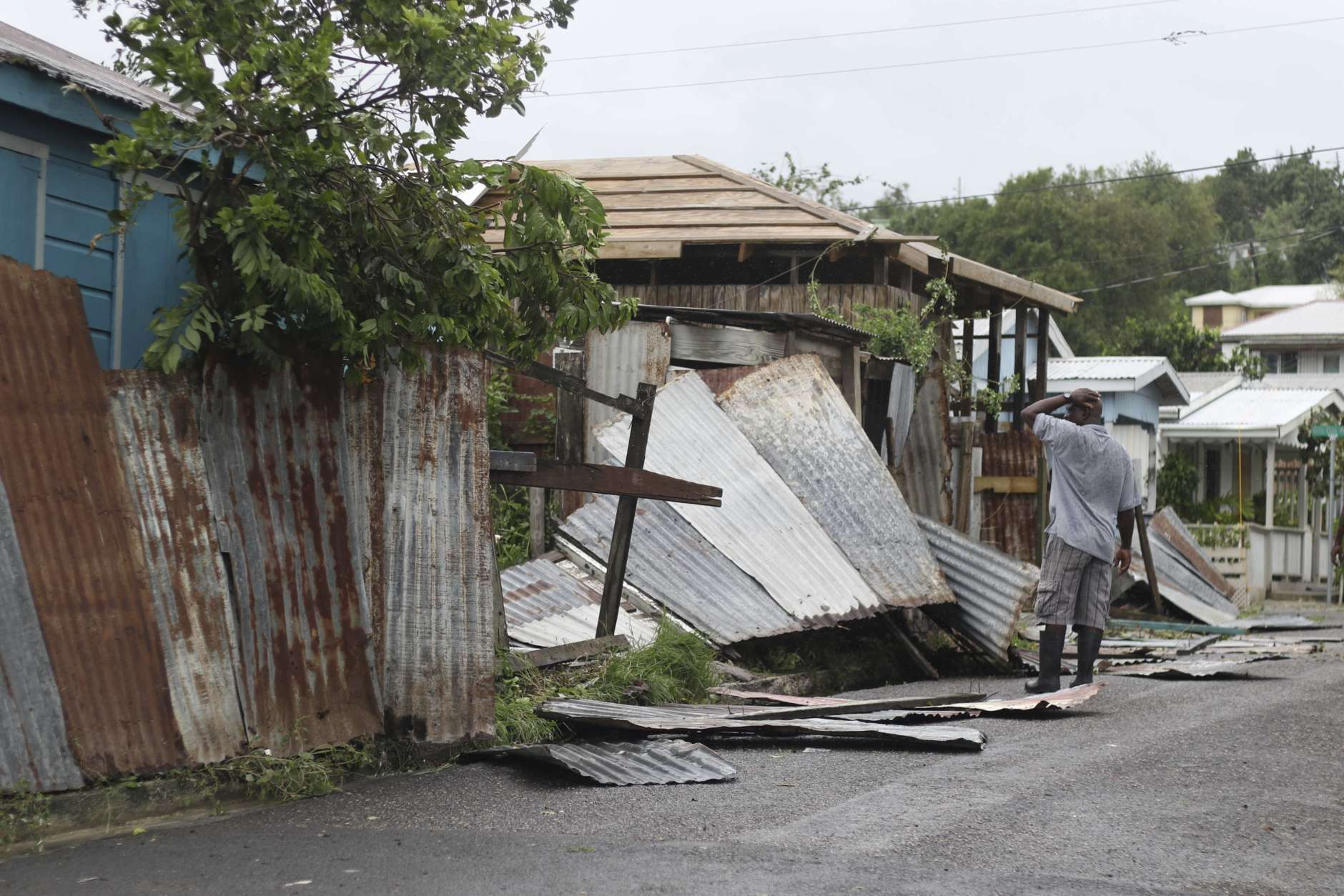 A man surveys the wreckage on his property after the passing of Hurricane Irma, in St. John's, Antigua and Barbuda, Wednesday, Sept. 6, 2017. Heavy rain and 185-mph winds lashed the Virgin Islands and Puerto Rico's northeast coast as Irma, the strongest Atlantic Ocean hurricane ever measured, roared through Caribbean islands on its way to a possible hit on South Florida. (AP Photo/Johnny Jno-Baptiste)