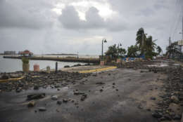 Rocks are scattered on a road in the aftermath of Hurricane Irma, in Fajardo, Puerto Rico, Thursday, Sept. 7, 2017. Irma cut a path of devastation across the northern Caribbean, leaving at least 10 dead and thousands homeless after destroying buildings and uprooting trees. More than 1 million people in Puerto Rico are without power. (AP Photo/Carlos Giusti)