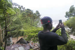 A man takes video with his cell phone as Hurricane Irma passes over Samana, Dominican Republic, Thursday, Sept. 7, 2017. Hurricane Irma cut a path of devastation across the northern Caribbean. (AP Photo/Tatiana Fernandez)
