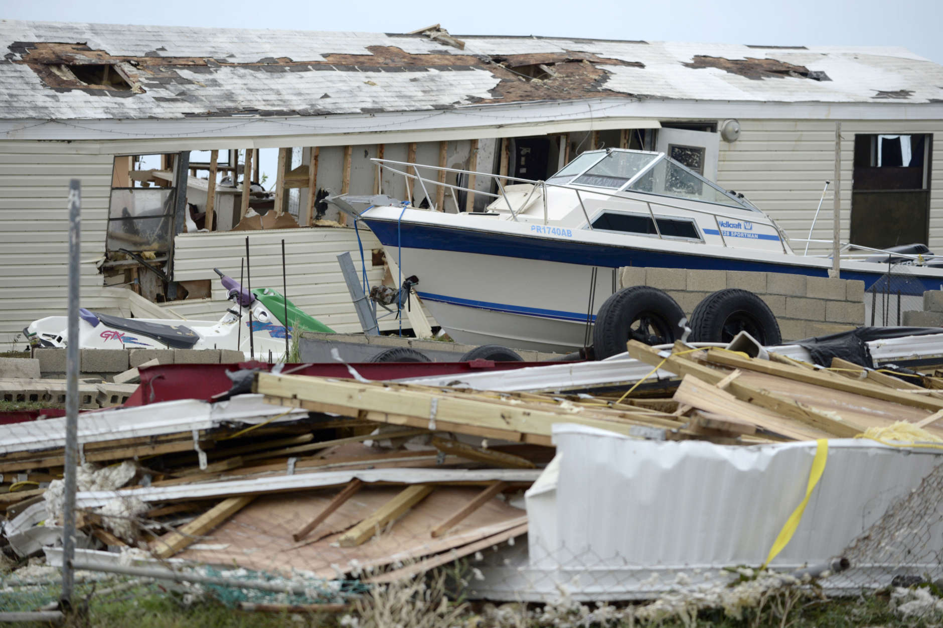 A pleasure boat stands next to a destroyed home after the passing of Hurricane Irma, in Culebra, Puerto Rico, Thursday, Sept. 7, 2017. About a million people were without power in the U.S. territory after Irma passed just to the north, lashing the island with heavy wind and rain. Nearly 50,000 also were without water. (AP Photo/Carlos Giusti)
