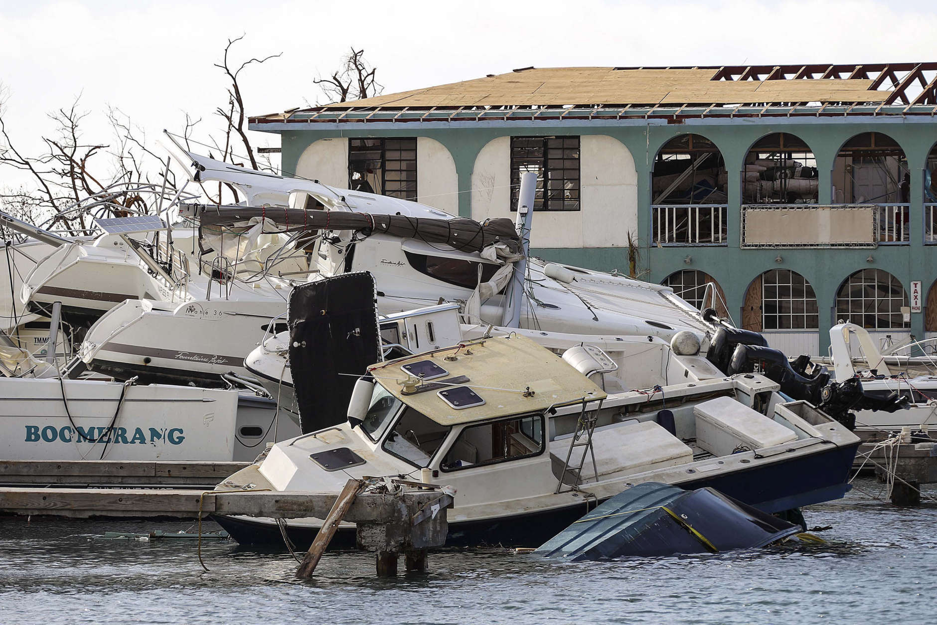 This undated photo provided on Sunday Sept. 10, 2017 by the British Ministry of Defence, shows the destruction in Road Town, Tortola, British Virgin Islands left by Hurricane Irma. The death toll from Hurricane Irma has risen to 22 as the storm continues its destructive path through the Caribbean. (Joel Rouse/MOD via AP)