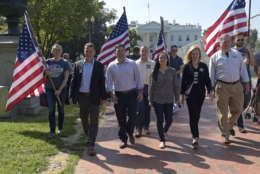 Protesters march from the White House to the Russian ambassador's residence in Washington, Saturday, Sept. 16, 2017, during a rally encouraging President Donald Trump and House Speaker Paul Ryan to defend American democracy from Russian interference. (AP Photo/Susan Walsh)