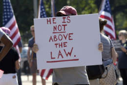 Protesters gather in front of the White House in Washington, Saturday, Sept. 16, 2017, during a rally encouraging President Donald Trump and House Speaker Paul Ryan to defend American democracy from Russian interference. (AP Photo/Susan Walsh)