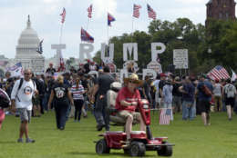 """With the U.S. Capitol in the background, people gather on the National Mall in Washington, Saturday, Sept. 16, 2017, to attend a rally in support of President Donald Trump in what organizers are calling 'The Mother of All Rallies."""" (AP Photo/Susan Walsh)"""