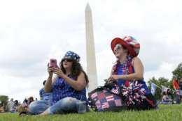 """Sheri Swick, left, of Le Vale, Md., and her daughter Angel Schultz, right, of Cumberland, Md., sits on the National Mall in Washington, Saturday, Sept. 16, 2017, as they attend a rally in support of President Donald Trump in what organizers are calling 'The Mother of All Rallies."""" (AP Photo/Susan Walsh)"""